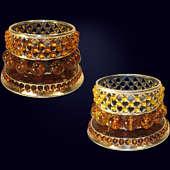 Подсвечник «Солнышко» из янтаря с декором из белой бронзы и серебра 875 пробы