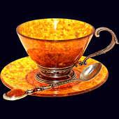 Чашка чайная ажурная из янтаря с ложкой с декором из белой бронзы