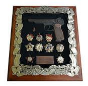 Панно с пистолетом Стечкина и наградами СССР