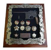 Панно с пистолетом Маузер и наградами СССР