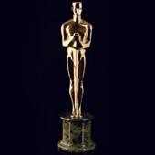 Точная копия статуэтки «Оскар» из полированной латуни на пьедестале из камня